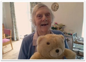 Lady extremely happy with her teddy bear