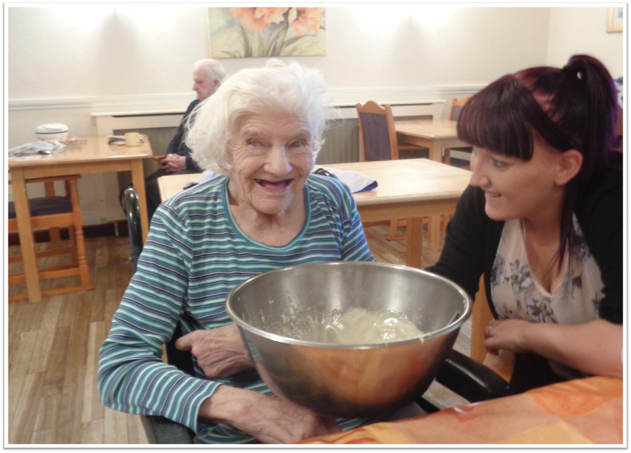 Lady enjoying baking a cake